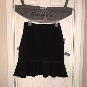 Black skirt with ruffle on the bottom
